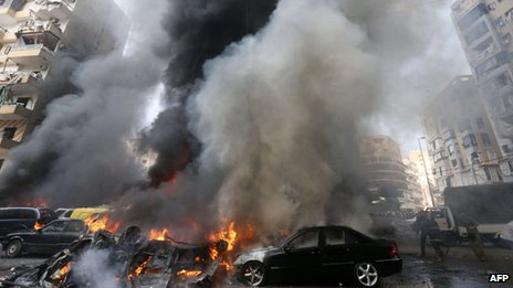 Smoke rises from burning cars at site of an explosion in Beirut's southern suburb neighbourhood of Bir al-Abed on July 9, 2013