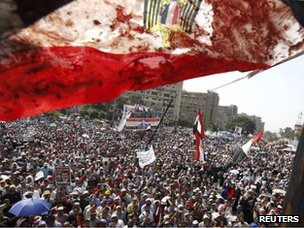 Blood-stained Egyptian flag at a protest in Cairo (8 July 2013)