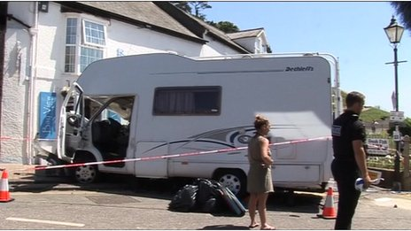 Damaged motorhome and police cordon