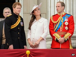 Prince Harry, the Duchess of Cambridge and Prince William on the balcony of Buckingham Palace during Trooping the Colour on 15 June