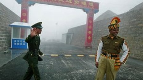 In this photograph taken on July 10, 2008, a Chinese soldier (L) and an Indian soldier stand guard at the Chinese side of the ancient Nathu La border crossing between India and China.