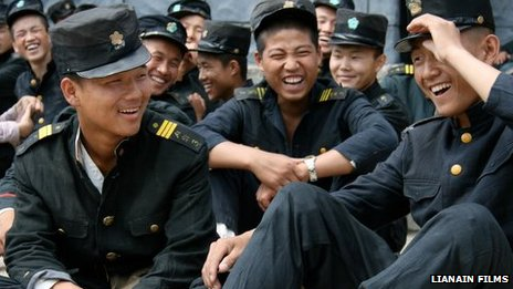 Young soldiers acting as extras on the set of North Korean director Pyo Hang's military film