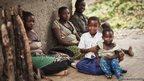 Tanzanian schoolgirl Sylvia with her family
