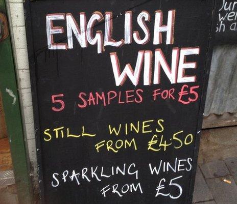 An blackboard advertising English wine