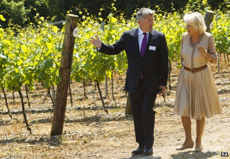 The Duchess of Cornwall walking with managing director Ian Kellett during her visit to Hambledon Vineyard in Hampshire
