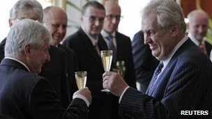 Czech President Milos Zeman (right) celebrates after swearing in new Prime Minister Jiri Rusnok (left)