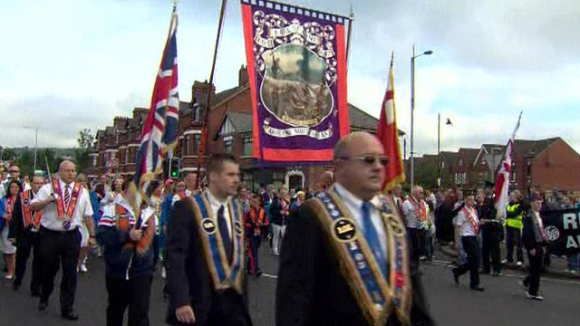 Orange parade past Ardoyne shops