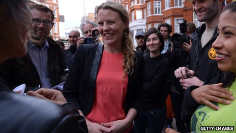 Sarah Harrison standing in a crowd of people in London