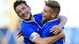 Michael Gault celebrates with a team-mate after putting Linfield ahead
