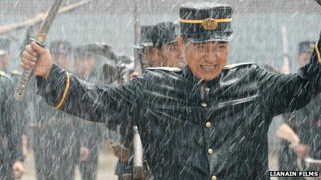Actors on the set of North Korean director Pyo Hang's military film