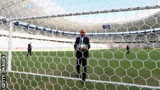 Howard Webb tests the Goal Control system before Brazil play Mexico in the Confederations Cup
