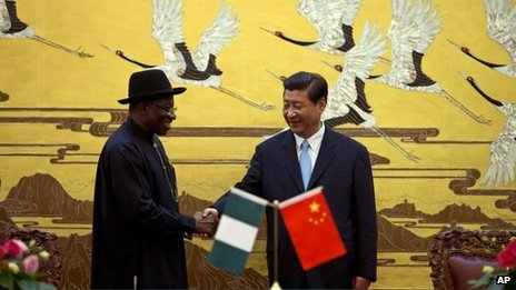 Chinese President Xi Jinping, right, shakes hands with Nigerian President Goodluck Jonathan in Beijing on 10 July