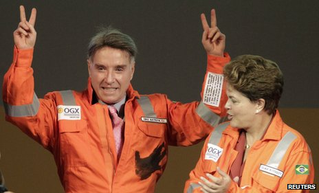 Brazilian billionaire Eike Batista (L), gestures next to Dilma Rousseff on 26 April