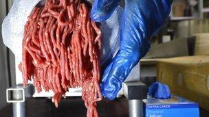Beef being put through a mincer