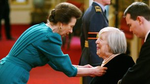 Princess Anne presents Anna Wing with an MBE