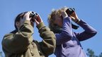 Girl and woman birdwatching in Cornwall