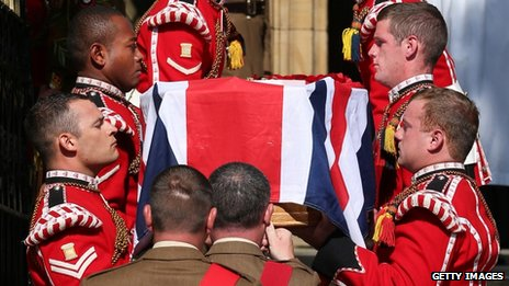 Lee Rigby's coffin being carried