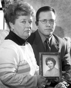 The sister and nephew of Mary Sullivan hold a photograph of the victim in Rockland, Massachusetts. March 2000