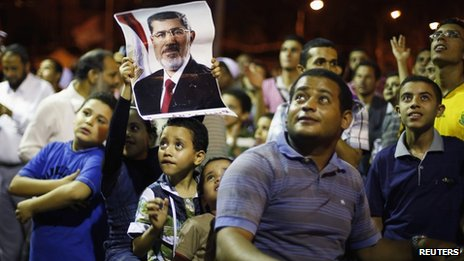 Supporters of a pro-Morsi sit in in Cairo on 11 July 2013