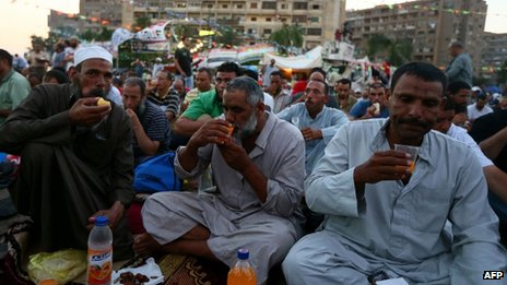 Muslim Brotherhood supporters break the fast outside Cairos Rabaa al-Adawiya on 11 July 2013