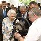 Queen Elizabeth II meeting Noel Thompson, a coach trimmer for Bentley cars