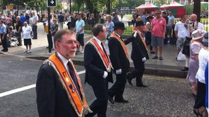 The DUP's Nelson McCausland and Nigel Dodds marched in Belfast City Centre