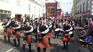 The Whitewater pipe band lead the Armagh parade through Newtownhamilton