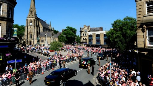 Crowds gather outside Bury Parish Church
