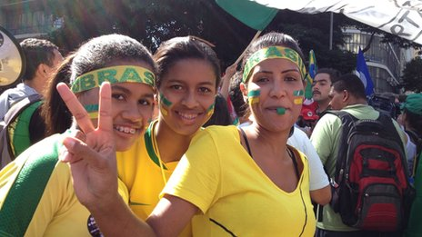 Three young women protesting in Rio in June 2013