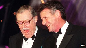 Alan Whicker with Michael Palin in 1998