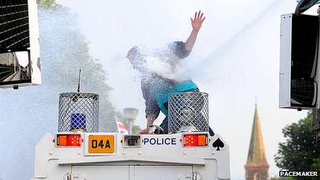 Mon on police Land Rover hit with water cannon jet