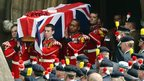 The coffin of Fusilier Lee Rigby is carried from Bury Parish church in Greater Manchester