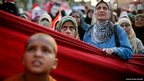 Supporters of deposed Egyptian President Mohamed Morsi listen to a speech during a protest in Cairo