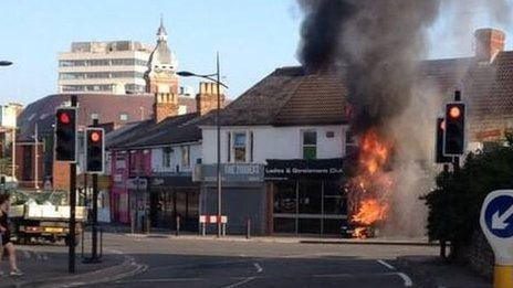 Car on fire inside the entrance of a club in Swindon