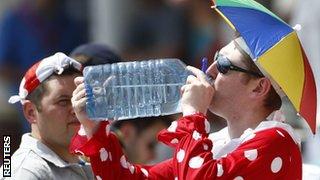 A fan takes on water