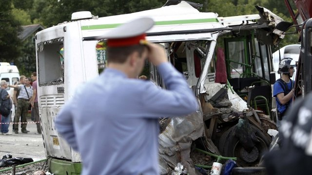 Members of the emergency services and police work at the scene of a collision between a bus and a truck outside Moscow