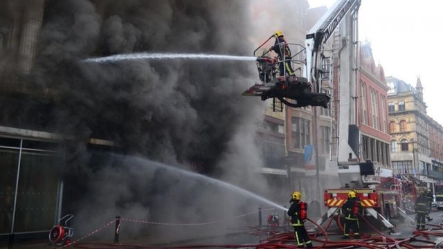 Firefighters tackle a major fire in a shop in Manchester city centre