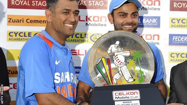India's Mahendra Dhoni and Virat Kohli with the tri-series trophy