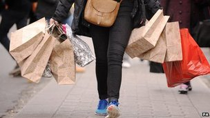 Person carrying several shopping bags