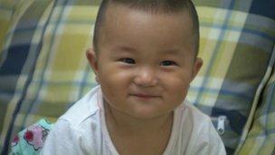 Liang Jinfang's son, nicknamed Huhu