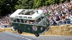 A vehicle goes over an obstacle as they compete in the Red Bull Soapbox race in London
