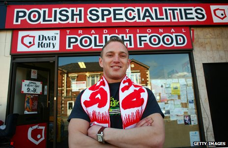 A man stands in front of a speciality Polish shop