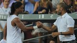 Ronaldinho (left) shakes hands with his former manager Pep Guardiola