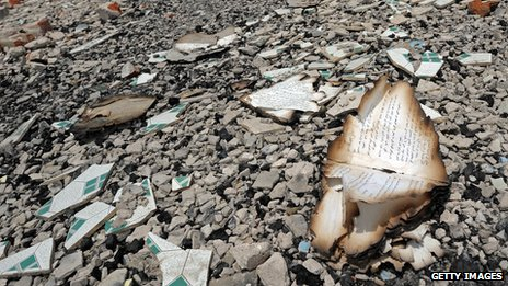 Burnt pages of religious books on ground in Meiktila, Burma, on 4 June 2013