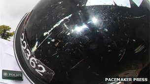 The PSNI showed damage to one officers helmet, caused by a ceremonial sword