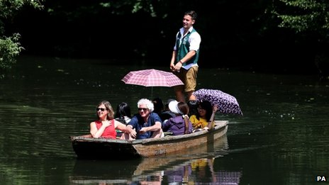 Punters enjoy the summer sunshine as they make their way along the river Cam in Cambridge on 15 July 2013