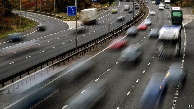 motorway with blurred cars on it