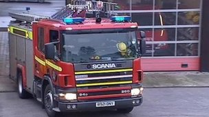 Fire engine leaving a station