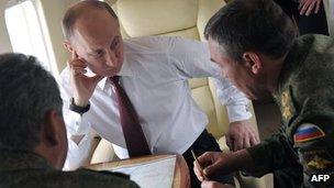 Russian President Vladimir Putin talks with Army Chief-of-Staff Sergei Gerasimov