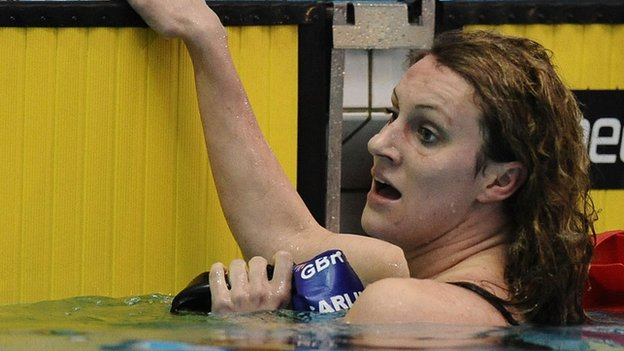 Jazz Carlin hangs on to the side of the pool after completing a race